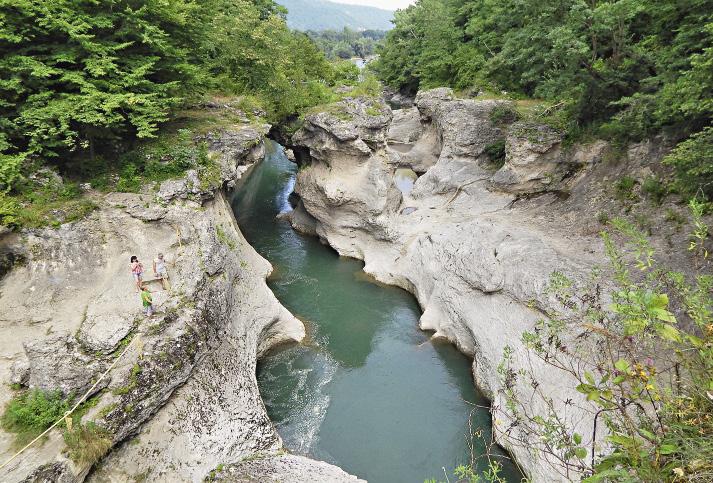 The Belaya River bursts through the Khadzhokhskiy Gorge, ripping its way through the cliffs.